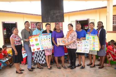 Mrs. Sita Nagamootoo presents teachers of the Arapaima Nursery School with teaching aids.