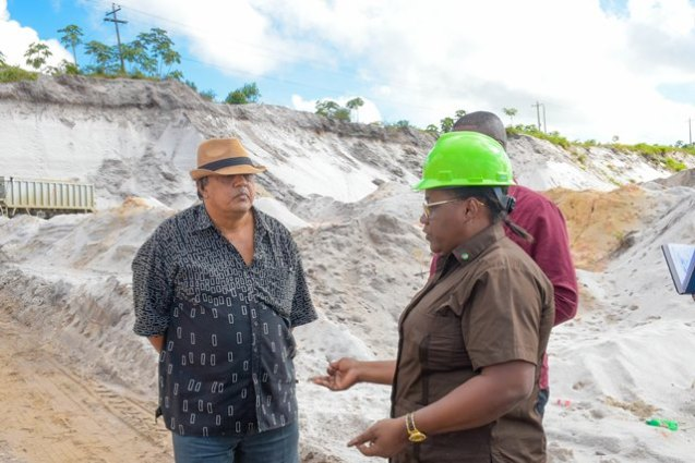 Minister Simona Broomes discussing the faults of mining with sandpit operator, Fizur Mohamed.