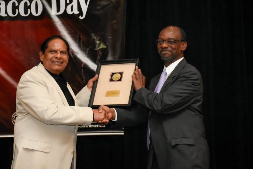 Prime Minister, Moses Nagamootoo receives the award from Dr. Anselm Hennis, Director Non- Communicable Diseases and Mental Health, PAHO/WHO, WDC