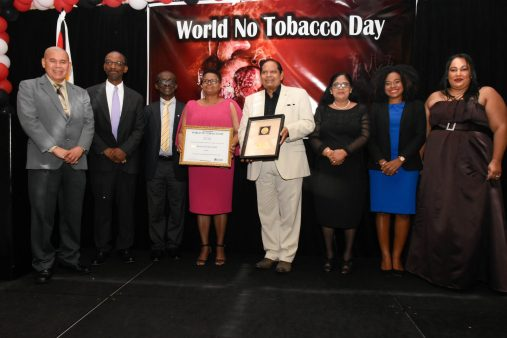 Minister of Public Health, Volda Lawrence and Prime Minister Moses Nagamootoo flanked by those who have made contributions resulting kin the receipt of this award