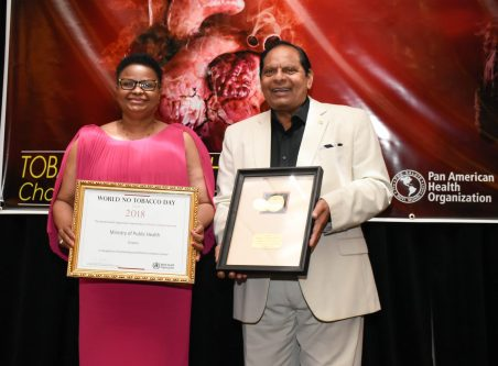 Prime Minister, Moses Nagamootoo displays the World No Tobacco Award and Minister of Public Health, Hon Volda Lawrence displays the World Tobacco Day Certificate