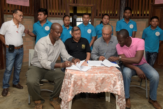 Minister of Indigenous Peoples' Affairs, Sydney Allicock, Permanent Secretary, Alfred King and Civil Engineer, Trilloyd Allen signing the contract for the construction of the Green Enterprise Centre.