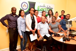 Communication Specialist Dr Rovin Deodat, Bartica's Deputy Mayor Kamal Persaud and Regional Manager Michella Abraham- Ali with some of the new broadcasters on Monday.