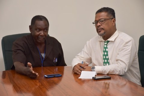 President of the Guyana Bauxite and General Workers Union Lincoln Lewis and Ministry of Social Protection's Chief Labour Officer Charles Ogle speaking during the meeting.