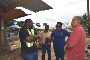 Minister within the Ministry of Public Infrastructure, Annette Ferguson and Regional Chairman of Region Seven, Gordon Bradford being updated on the works on the site by GPL engineer.