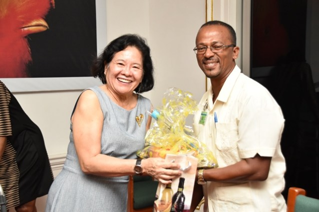 First Lady Mrs. Sandra Granger presenting Diver/ Administration Support Officer, Mr. Tyrone Isaacs at the Pre-Father`s Day Celebration held at State House.