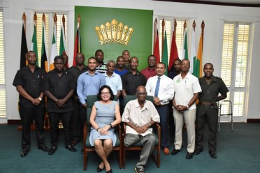 First Lady Mrs. Sandra Granger and male staff members of the Office of the First Lady at the Pre-Father`s Day Celebration held at State House.