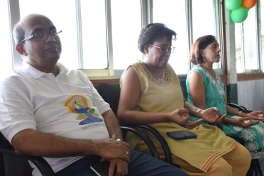 Minister of Public Telecommunication, Catherine Hughes, practicing breathing exercises. Also, in photo is High Commissioner of India to Guyana, V. Mahalingam, and former first lady Deolatmachmee Ramotar
