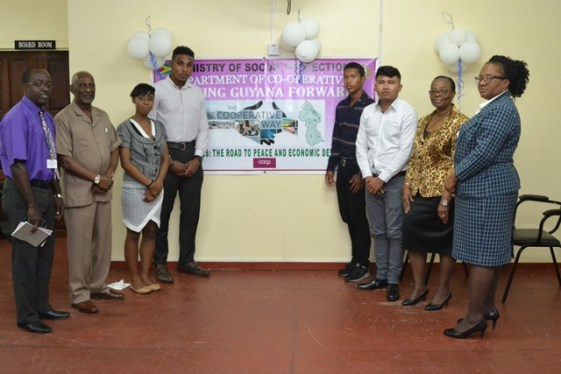 (from left) Principal Personnel Officer, Shelton Daniels, Minister within the Ministry of Social Protection, Keith Scott, Apprentices, Ashley Johnson, Julian Monize, Alonzo Abraham, Marlon Edwards, Social Protection Permanent Secretary, Lorene Baird and Chief Co-op Development Officer, Perlina Gifth.