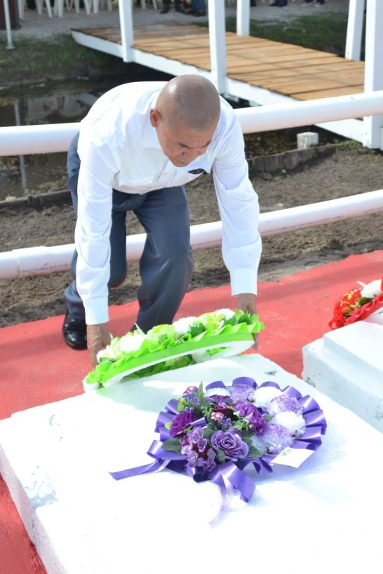 Minister of Social Cohesion Dr. George Norton laying a wreath at the grave site of the Enmore Martyrs