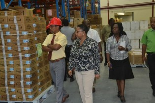 Minister of Public Health, Volda Lawrence and a team from the Ministry of Public Health examining medical supplies and drugs at the Supply Chain Management Complex at Diamond, East Bank Demerara.