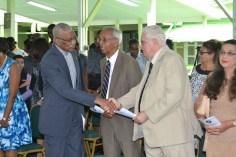 President David Granger greets Vibert Parvatan and Dr. Jose DaSilva of the St. John's Association of Guyana.