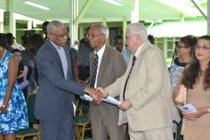 President David Granger greets Vibert Parvatan and Dr. Jose DaSilva of the St. John's Association of Guyana.