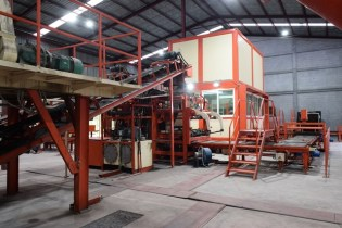 A section of the QGMq10 bloc factory machine which produces the blocks.