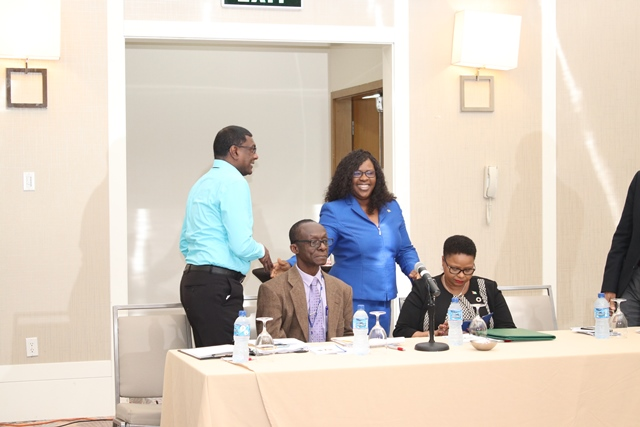 CMO Dr Persaud and Dr Karen Cummings share a light banter in the presence of Dr Adu-Kro and Minister Lawrence.