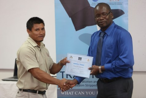 Mines Officer, Donnell Perry receiving his certificate.