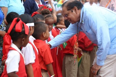 Prime Minister Moses Nagamootoo chats with one of the students who came to greet him.