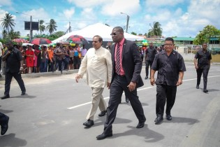 Minister of Public Infrastructure, David Patterson (outside) and Prime Minister, Moses Nagamootoo.