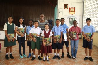 Minister Henry poses with the top 10 performers of Region Six