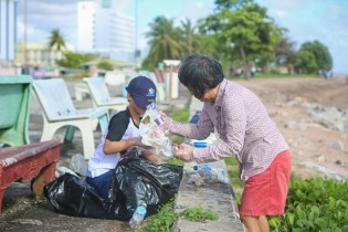 This mother son duo joined the early morning clean-up efforts.