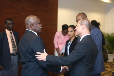Minister of State, Joseph Harmon, Minister of Citizenship, Winston Felix and Cuba's Vice Foreign Minister, Rogelio Sierra Diaz engaged in conversation.