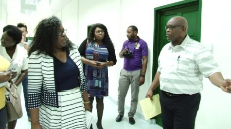 Colin Bynoe, Chief Executive Officer, New Amsterdam Regional Hospital offers Minister Dr. Karen Cummings and her team a tour of the hospital's new laboratory facility.