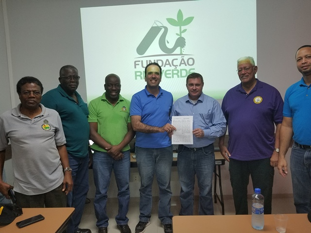 President of NF Agriculture Inc. Mr. Yucatan Reis and President of Rio Verde Research Institute Mr. Marino Franz after signing the MOU. Also in Photo. Agriculture Minisgter, Noel Holder.