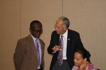 Sir Trevor at centre in conversation with Dr Adu-Krow. Seated is Ms Mausha Hutton, HCC Executive Director.