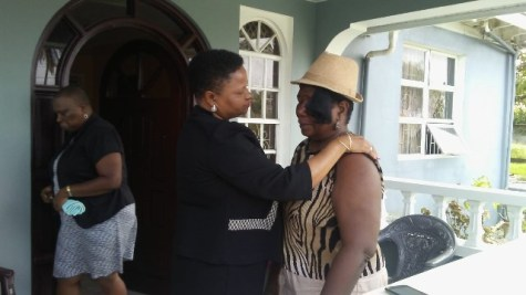 Minister of Public Health, Volda Lawrence consoles Jaqueline Allen-West, mother of the brothers killed in the Den Amstel Accident.