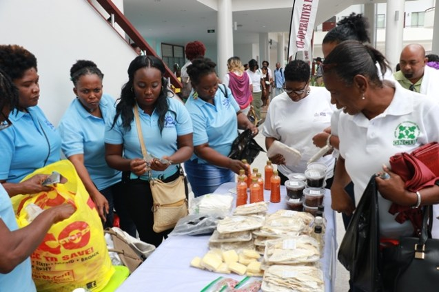 Attendees purchasing products on sale.