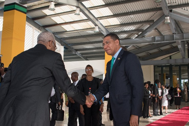 Chairman of CARICOM and Prime Minister of Jamaica Andrew Holness welcoming President David Granger to CARICOM Heads of Government meeting.