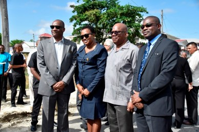 Minister of State, Mr. Joseph Harmon, Minister within the Ministry of Public Infrastructure, Ms. Annette Ferguson, Minister of Finance, Mr. Winston Jordan, and Minister of Public Infrastructure, Mr. David Patterson pose for a photo at the Commissioning Ceremony.