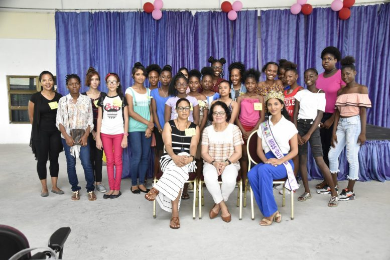 First Lady, Mrs. Sandra Granger (seated, centre) is flanked by (from left to right) pannellist Ms. Wanita Huburn and Miss Guyana, Ms. Ambika Ramraj. The participants of the Girls' Empowerment are pictured standing
