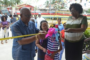 Minister of Finance, Winston Jordan and Regional Chairman of Region Four, Genevieve Allen, cut the ribbon to commission Ann's Grove Early Childhood Development Centres (ECDC)