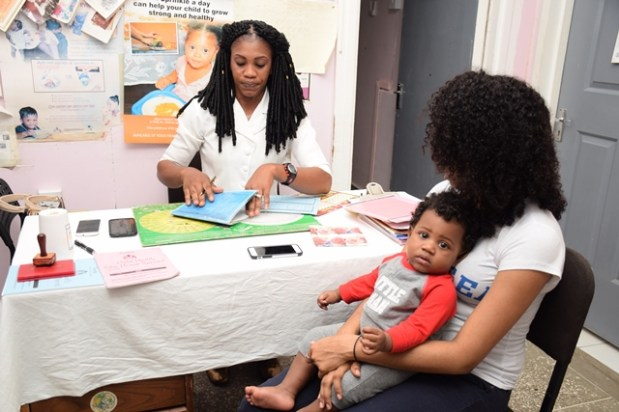A mother and child at post-natal (infant) clinic