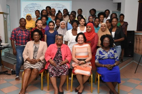 (From left to right) Secretary to the First Lady, Lieutenant Colonel Yvonne Smith, Clinical Social Worker, Ms. Ismay Griffith, The First Lady, Mrs. Sandra Granger and Gender Consultant at the Ministry of Social Protection, Ms. Hazel Halley-Burnett along with the participants of the Care for the Ederly Workshop.