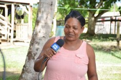 A Kwakwani resident happily shares how thankful she is for the CDC to DPI