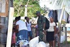 Lieutenant Colonel Kester Craig interacts with residents