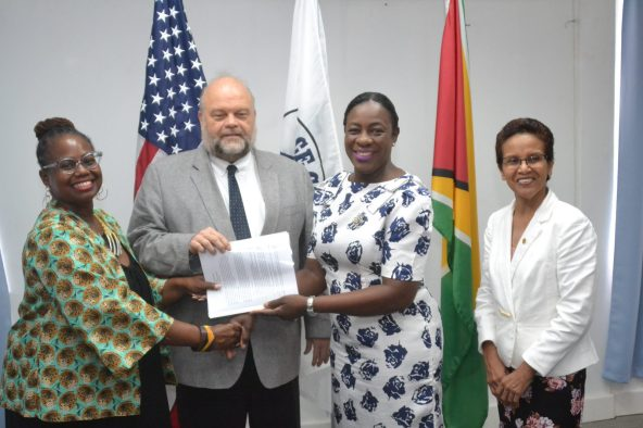 Peace Corps Guyana Country Director, Kury Cobham, US Ambassador Perry Holloway and Minister of Education, Nicolette Henry during a photo opportunity