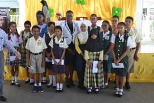 Minister of Education, Nicolette Henry along the country's top 15 2018 National Grade Six Assessment (NGSA) students.