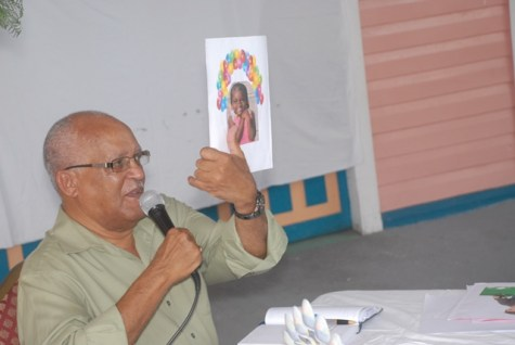 Ron Robinson showing a picture for the students.