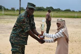 Alliah Shaw receiving her prize for 'Best Camper' from Chief of Staff of the GDF, Brigadier Patrick West.