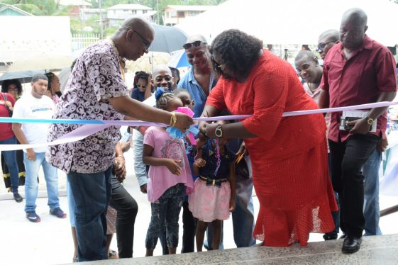 Minister Jordan (right) and Presidential Advisor Aubrey Norton (left) with other stakeholders cut the ribbon to declare the One Mile Wismar Early Childhood Development Centre open