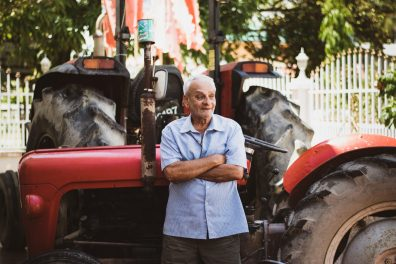 Ganga Persaud in front of his tractor