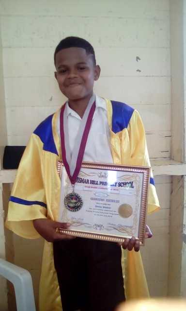 Demitri Waldron at his school's graduation.