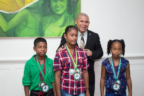 Minister of Social Cohesion with responsibility for Culture, Youth and Sport, Dr. George Norton along with [from left] Orlando Carrington, Annalee Williams and Somayia Orna.