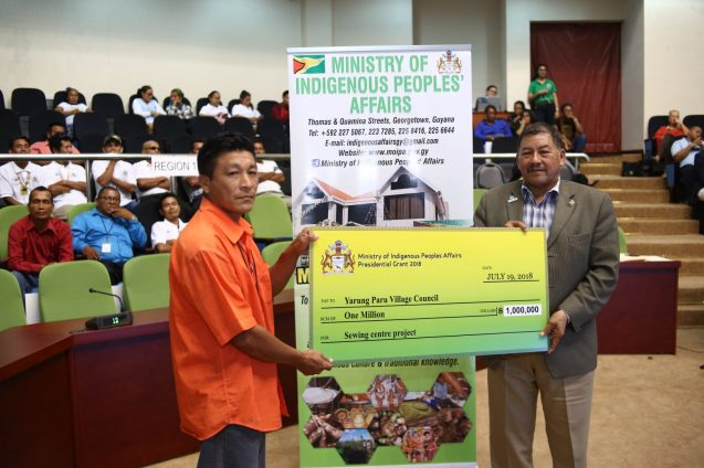 Toshao of Yarung Paru Village, Region Nine Shevnarine Cyprian receiving the presidential Grant from Minister of Indigenous Peoples Affairs, Sydney Allicock.