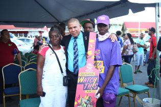 Minister of Social Cohesion, Dr. George Norton shares a moment with spectators at the launch of the Women's T20 Cricket World Cup Campaign