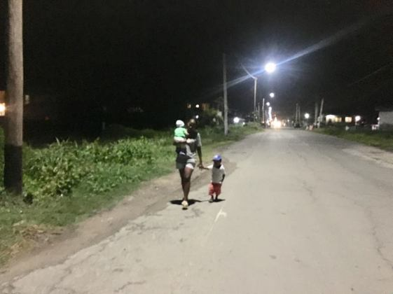 Tameka Richards takes a stroll out with her two children on the Stanleytown Public Road
