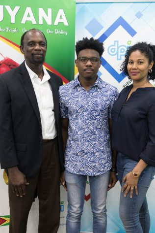 Christian Pile with his parents, Nigel Pile and Fayann Simpson-Pile